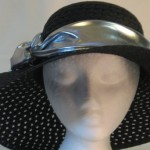"""Wide brim hat is black, paper braid with 5"""" brim shown with silver band"""