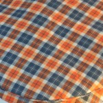 Flat Cap in Orange Navy Plaid - closeup
