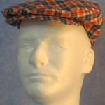 Flat Cap in Orange Navy Plaid - front male