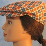 Flat Cap in Orange Navy Plaid - left female