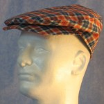 Flat Cap in Orange Navy Plaid - left male