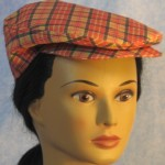 Flat Cap in Red Gold Plaid - front female