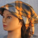 Newsboy Hat in Blue and Orange Plaid - front left