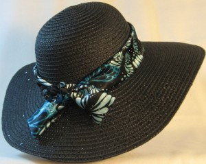 Wide brim hat is black with sequins shown with butterfly band-back