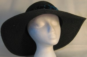 Wide brim hat in black with sequins and butterfly band