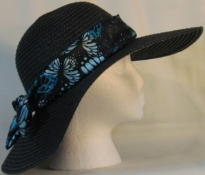 Wide brim hat in black with sequins and butterfly band-side