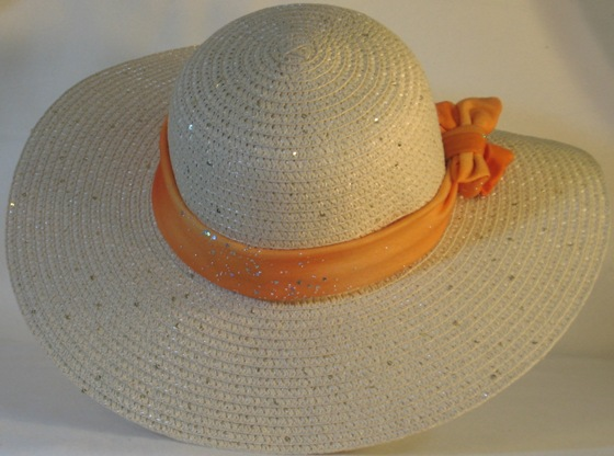 Wide brim hat is tan with sequins shown with orange band-back