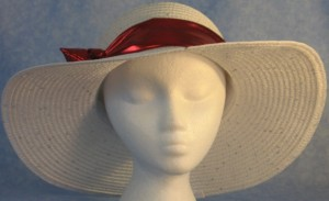 Wide brim hat is white with sequins shown with shiny, red band