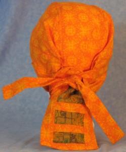 Hair Bag in Orange Sun Design with Brown Acorn Tail - back