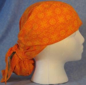 Hair Bag in Orange Sun Design with Brown Acorn Tail - side