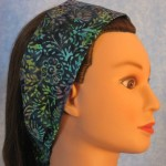 Headband in navy with aqua, purple & green batik - side