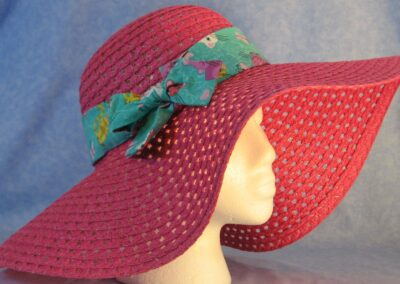 Wide brim hat is pink, paper braid shown with green cat band-side