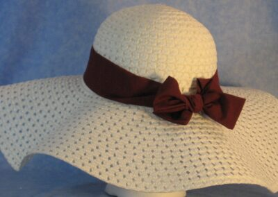 Wide brim hat is white, paper braid shown with maroon band-back