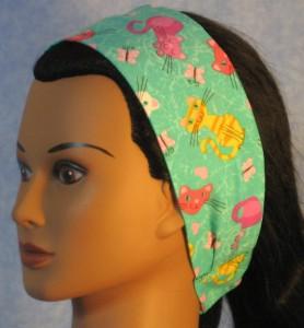 Headband in green cat print - left side