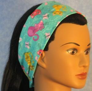 Headband in green cat print - right side