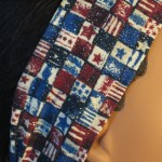 Headband in patriotic small flag print - closeup