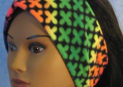Ear Warmer in Rainbow Crosses - left