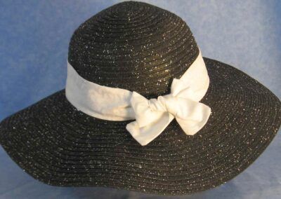 Wide brim hat in black with silver paper braid with white on white vines band-back