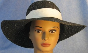 Wide brim hat in black with silver paper braid with white on white vines band-front