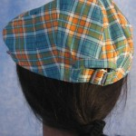 Flat Cap in Turquoise Orange Plaid - Female back