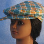 Flat Cap in Turquoise Orange Plaid - Female front
