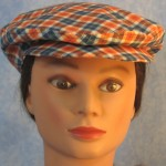 Flat Cap in Orange Navy Plaid - front female