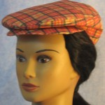 Flat Cap in Red Gold Plaid - front left female