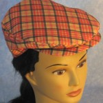 Flat Cap in Red Gold Plaid - front top female