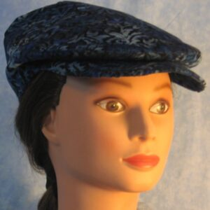 Ivy Flat Cap in Blue Black Flower Corduroy - front