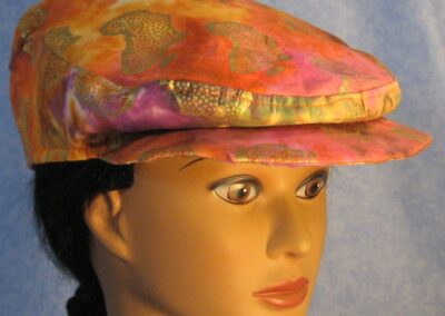 Flat Cap in Ethnic Print with Africa in Gold