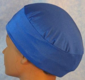 Skull Cap in Blue Swim Knit in Double Style - back with hair tucked in