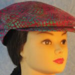 Flat Cap in Turquoise Green Dots on Pink Batik - front