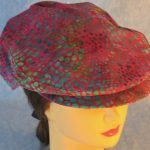 Flat Cap in Turquoise Green Dots on Pink Batik - front top
