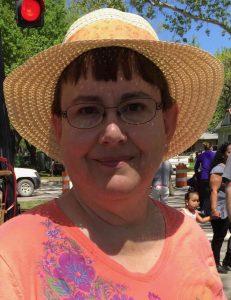 Floppy Hat with Orange Band on Wamego Lady