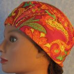 Skull Cap in Yellow Orange Green Paisley on Pink-Performance Knit-left