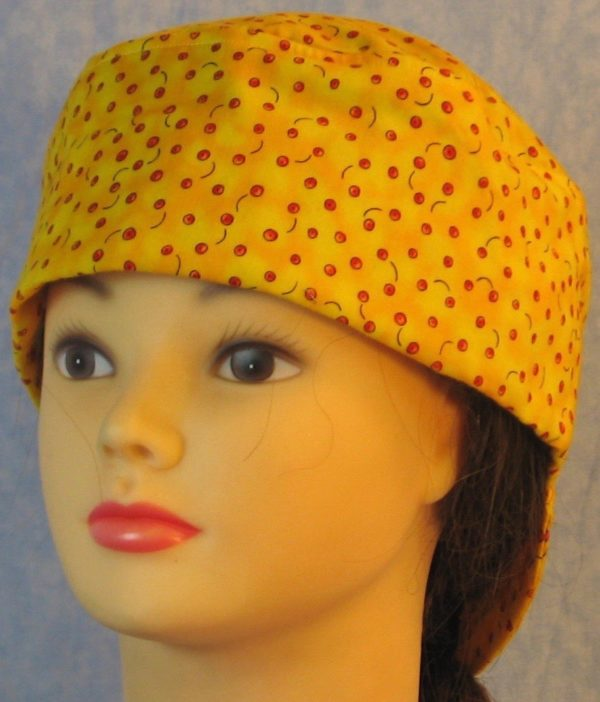 Welding Cap in Small Red Apples on Yellow-front