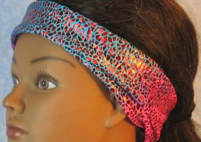 Headband-Red Sparkle Flakes on Turquoise Pink Tie Dye-folded left