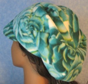 Newsboy-Turquoise Green White Rose-back left