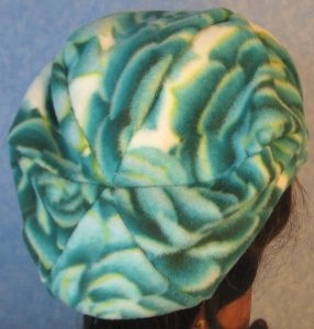 Newsboy-Turquoise Green White Rose-back right