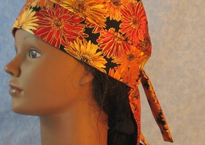 Do Rag in Yellow Orange Red Zinnia Flowers Outlined in Gold on Black-left