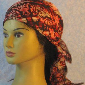Head Wrap in Red Cream Dark Brown Reflected Curlicues-left