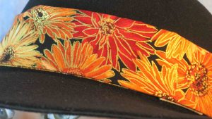 Floppy Band in Orange Red Yellow Brown Daisy Flowers with Gold-closeup