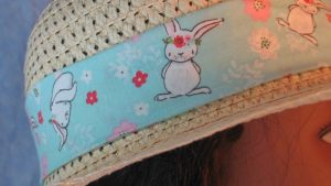 Floppy Band in White Bunny Pink White Red Flowers on Blue-tan closeup