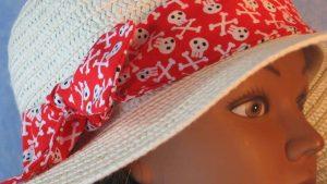 Floppy Band in White Skull Cross Bones on Red-closeup