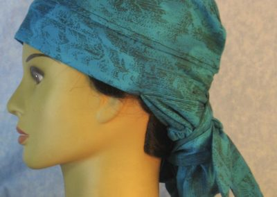 Hair Bag in Turquoise with Sun Clouds in Black Lines-left
