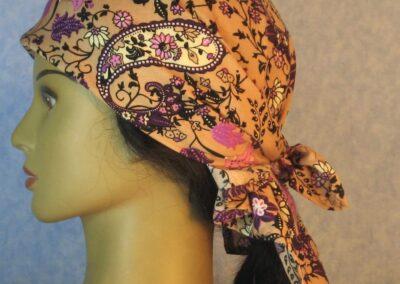 Head Wrap in Pink Purple Cream Black Flowers Paisleys on Tan-left