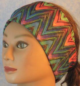 Headband in Turquoise Red Purple Green Yellow Black Chevron-front left