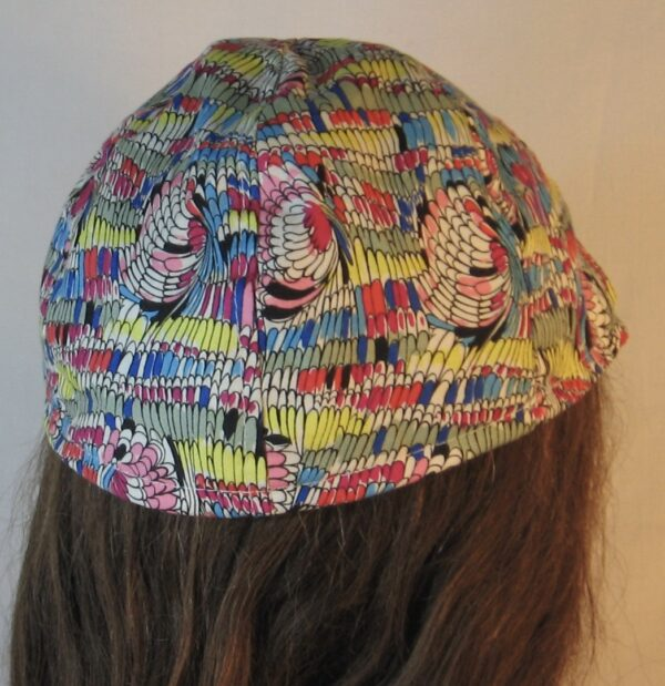 Duckbill in Feathers of Pink Yellow Blue Green-back