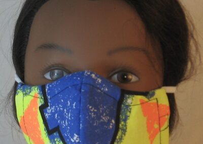 Face Mask Orange Triangles Blue Nose on Yellow-front