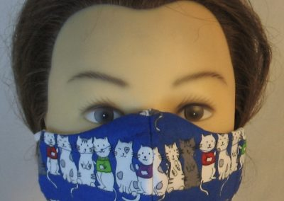 Face Mask in Cats in Sweaters on Blue - front